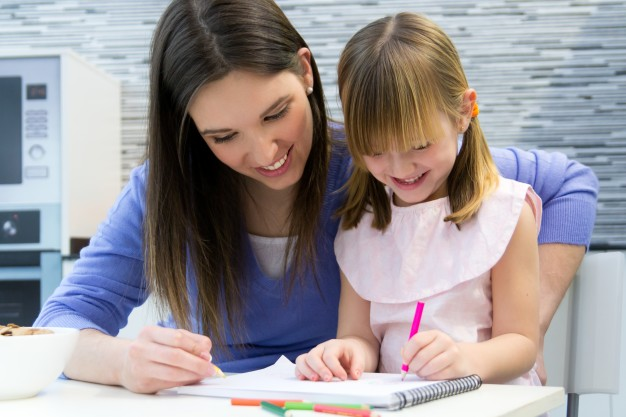 child-drawing-with-crayons-with-her-mom-at-home_1301-6422