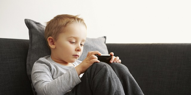 Innocent little kid using mobile phone